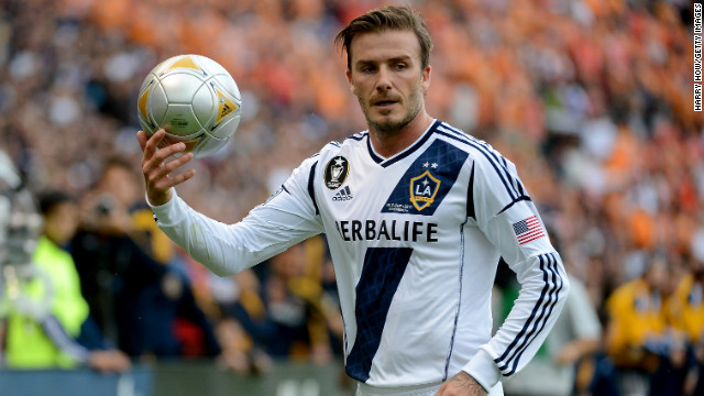 Beckham looks on while taking on the Houston Dynamo.