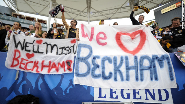 Fans hold up signs for Beckham at The Home Depot Center during the game.