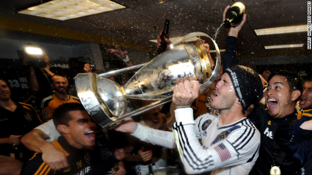 Beckham drinks out of the MLS Trophy after the victory.