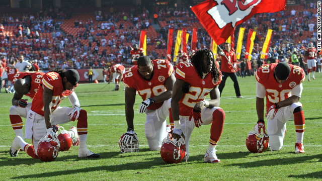 The Kansas City Chiefs kneel and pray before a game against the Carolina Panthers on Sunday, December 2, at Arrowhead Stadium in Kansas City, Missouri.