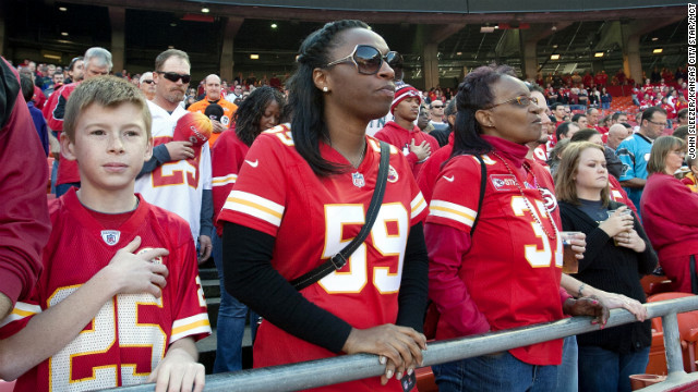 Natalie Samson wears the No. 59 jersey, which was Jovan Belcher's number, as she stands for a moment of silence on Sunday.
