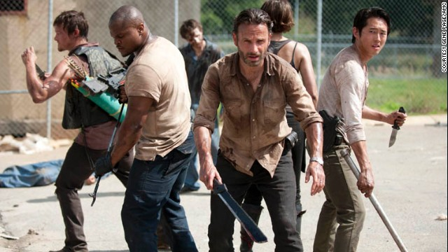 Norman Reedus, from left, IronE Singleton, Andrew Lincoln and Steven Yeun star in AMC's