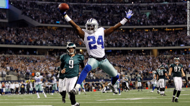 Morris Claiborne of the Dallas Cowboys celebrates while crossing the goal line to score on a fumble recovery on Sunday, December 2, at Cowboys Stadium in Arlington, Texas.