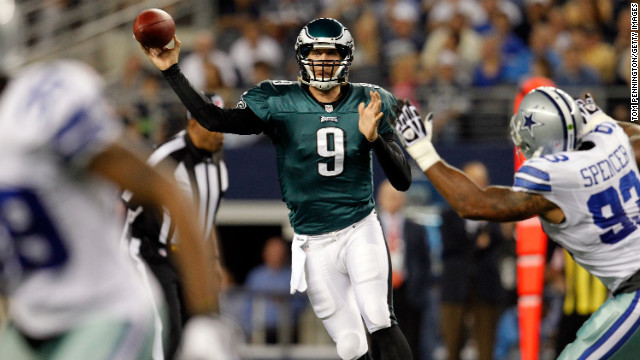 Quarterback Nick Foles of the Philadelphia Eagles looks for an open receiver Sunday under pressure from Anthony Spencer of the Dallas Cowboys.
