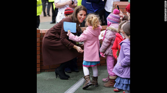 Catherine greets a young girl during a walkabout as she visits Alder Hey Children's Hospital on February 14, 2012, in Liverpool, England.