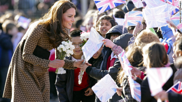 Catherine talks with flag-waving schoolchildren as she arrives for a visit to The Art Room's classroom at Rose Hill Primary School on February 21, 2012, in Oxford, England. Since the beginning of the year, Catherine has become patron of four charities, including the Art Room.
