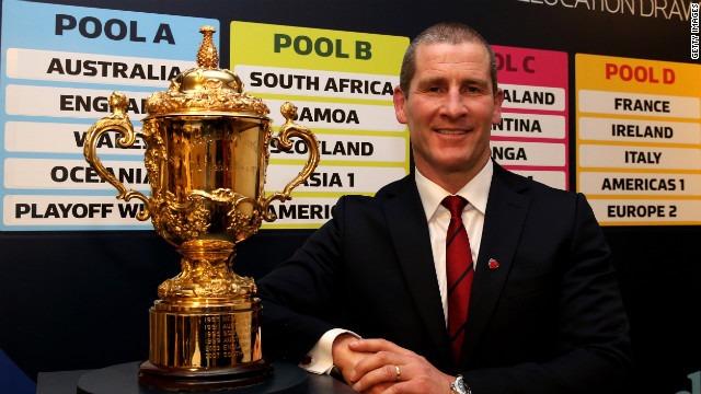 England rugby coach Stuart Lancaster with the Webb Ellis trophy after the draw for the 2015 World Cup, which his country will host. England will be in the toughest group along with Wales and Australia.