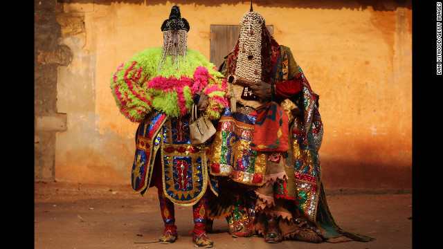 "January 10: ""Voodoo spirits"" walk the streets in Ouidah, Benin, for the annual Voodoo festival. Ouidah is the Voodoo heartland in this West African nation and thought to be the spiritual birthplace of Voodoo."