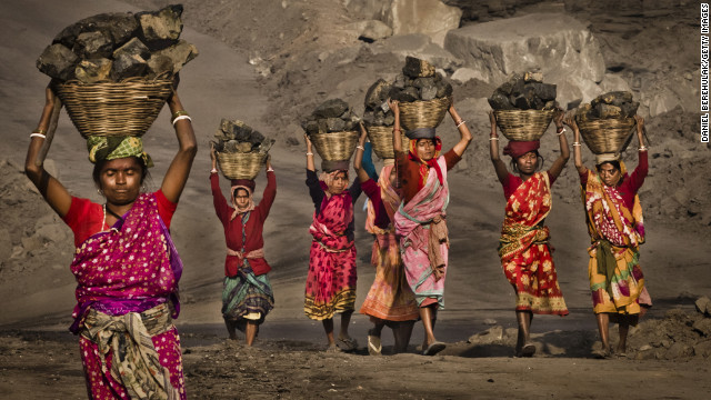 February 11: Villagers carry coal scavenged illegally from an open-cast coal mine in the village of Jina Gora, India. Claiming that a decades-old underground coal fire threatened the homes of villagers, the government relocated more than 2,300 families.