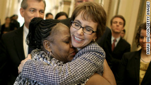 Former U.S. Rep. Gabrielle Giffords hugs House Cloak Room attendant Ella Terry after resigning from Congress in January 2012