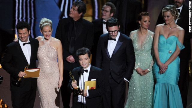 "<strong>February 26: </strong>Surrounded by the cast and crew, producer Thomas Langmann accepts the best picture award for ""The Artist"" during the 84th Annual Academy Awards in Hollywood. The silent, black-and-white film garnered five Oscars."