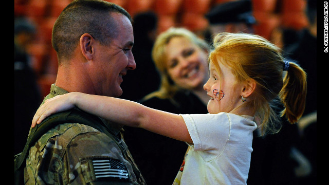 <strong>March 28: </strong>Sgt. 1st Class Paul Brady of the 182nd Infantry Massachusetts National Guard embraces his 6-year-old daughter, Regan, during a welcome home ceremony in Melrose, Massachusetts. The 182nd Infantry Regiment, one of the original units in the United States military, returned from a yearlong deployment in Afganistan.