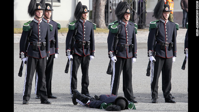 March 20: A soldier faints as Camilla, Duchess of Cornwall, and Prince Charles, Prince of Wales, arrive for a wreath-laying ceremony at the National Monument at Akershus Fortress in Olso, Norway. The royals were on a Diamond Jubilee tour of Scandinavia.