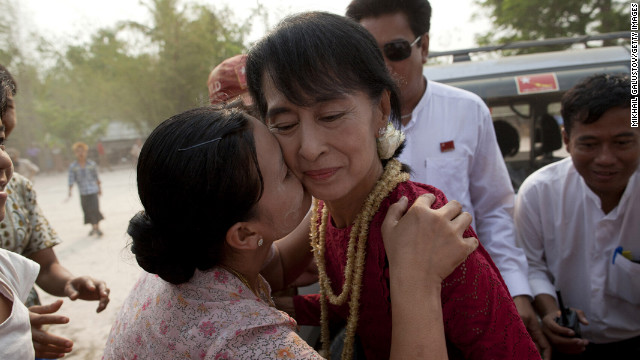 April 1: A supporter kisses Aung San Suu Kyi, leader of the National League for Democracy, as she visits polling stations in her constituency as Burmese vote in parliamentary elections in Kawhmu, Myanmar. She won a seat in parliament in Myanmar's first multiparty elections since 1990.
