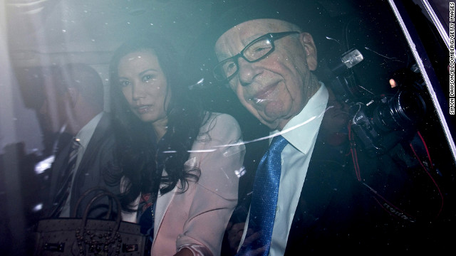 April 26: Rupert Murdoch, chief executive officer of News Corp., and his wife, Wendi, are driven from their London apartment. Testifying before an independent British inquiry into journalistic ethics, Murdoch admitted to a cover-up of abuses at the News of the World tabloid and apologized for not paying more attention to the phone-hacking scandal.