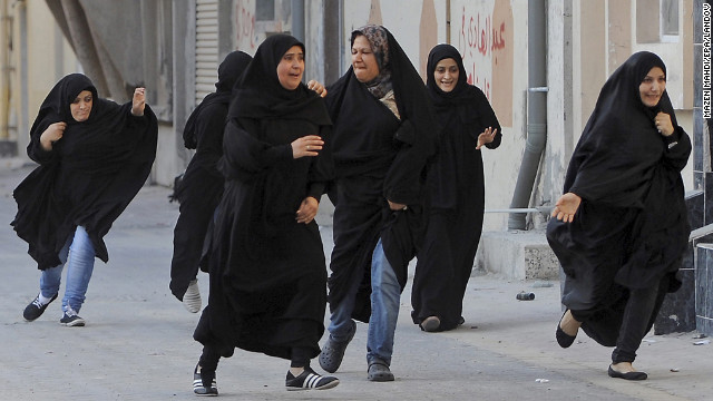 "June 27: Protesters run for cover as police arrive to disperse a rally demanding human rights reforms in the village of Buri, south of Bahrain's capital, Manama. A court in Bahrain sentenced prominent activist Nabeel Rajab to three years in prison in August ""for participating in illegal rallies and gatherings."""