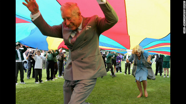 <strong>July 19:</strong> Prince Charles, Prince of Wales, and Camilla, Duchess of Cornwall, take part in a parachute game during a visit to Saumarez Park in St Peter Port, United Kingdom. They were taking part in a Diamond Jubilee visit to the Channel Islands.