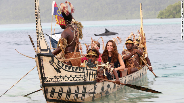 September 17: Catherine, Duchess of Cambridge, and Prince William, Duke of Cambridge, travel in a traditional canoe during a visit to Tavanipupu Island on their Diamond Jubilee tour of the Far East.