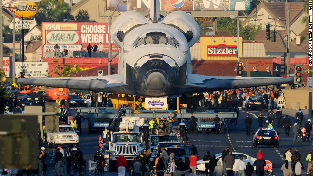 October 12: Space Shuttle Endeavour is transported to The Forum arena for a stopover and celebration in Inglewood, California. The space shuttle was on 12-mile journey from the Los Angeles International Airport to the California Science Center to go on permanent public display. 