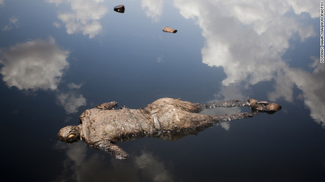 April 17: A Sudan Armed Forces soldier lies dead in a pool of oil next to a leaking oil facility. He had engaged in heavy fighting with Sudan People's Liberation Army troops from South Sudan.