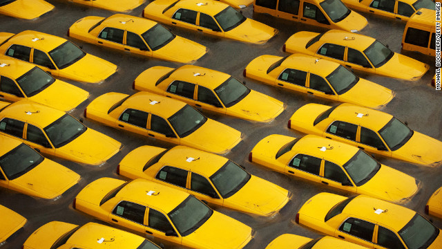 October 30: Taxis sit in a flooded lot in Hoboken, New Jersey, after Superstorm Sandy devastated the region. The storm slammed ashore near Atlantic City, New Jersey, after forming in the Caribbean and sweeping northward, killing 182 people from Haiti to Canada.