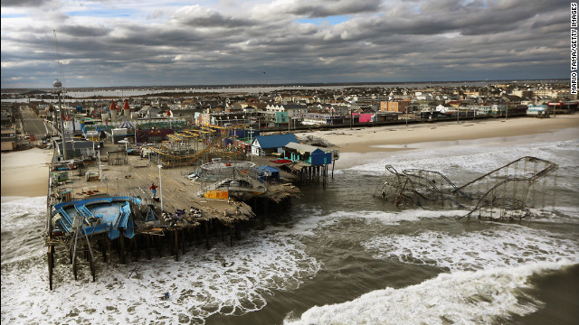 <strong>October 31:</strong> Waves break in front of a destroyed amusement park wrecked by Superstorm Sandy in Seaside Heights, New Jersey.