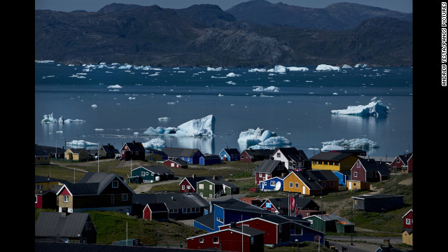 July 23: Icebergs from nearby glaciers float in the bay in Narsaq, Greenland.