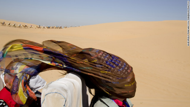 August 21: A woman rides through the Gobi Desert in Mongolia.