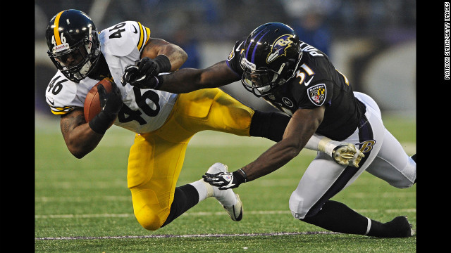 Fullback Will Johnson of the Pittsburgh Steelers is tackled by safety Bernard Pollard of the Baltimore Ravens on Sunday.