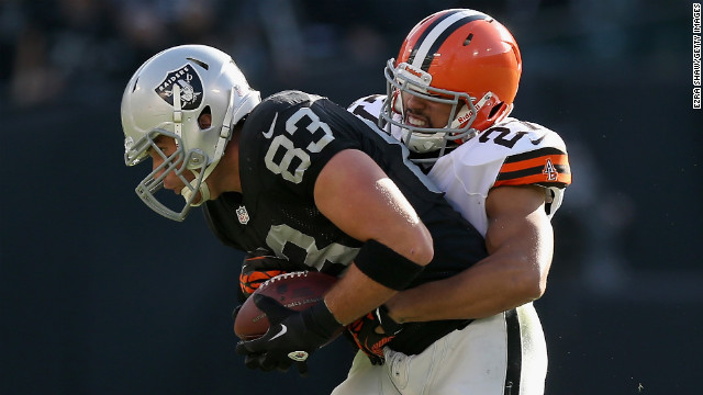 Brandon Myers of the Oakland Raiders is tackled by Eric Hagg of the Cleveland Browns on Sunday.