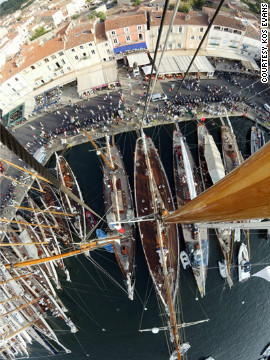 Kos photographed Saint Tropez harbor from the top of 52 meter schooner Eleonora. &quot;Whilst guest and crew were chatting on deck and strollers gathered on the promenade, I donned a harness and was hoisted 45 meters aloft,&quot; she said.
