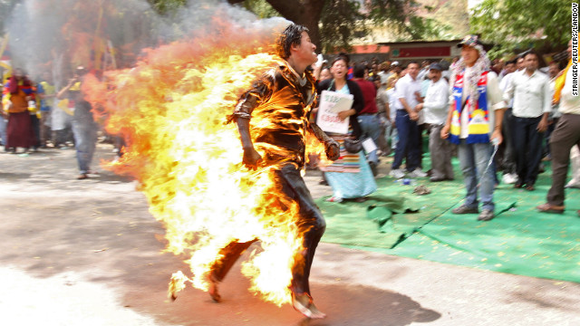 March 26: A Tibetan exile runs after setting himself on fire in New Delhi, India, during a protest against Chinese President Hu Jintao's upcoming visit.
