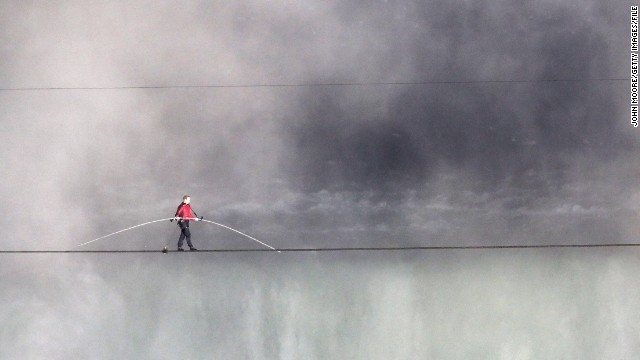 Wallenda tighropes over the Niagara Falls in June 2012, becoming the first person to cross directly over the falls from the United States into Canada.