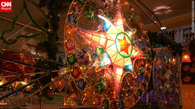 Christmas lanterns known as 'parols' light up many a Filipino mall, home or street, as seen in this image by Christian Bordo. They were created in 1928 by an artisan to help villagers find their way to churches to pray.