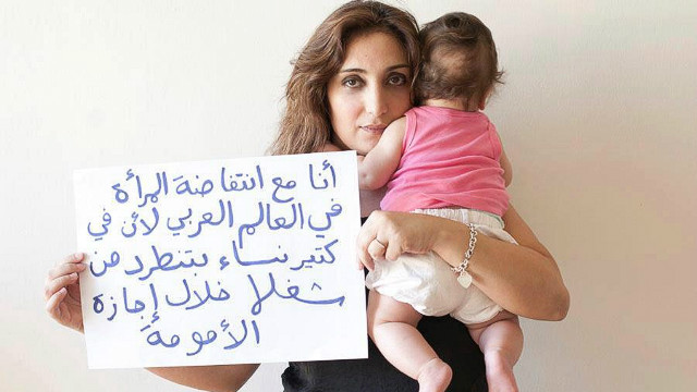 "The Uprising of Women in the Arab World photo campaign asked supporters to submit photos of themselves holding signs supporting the demands of Arab women. ""I am with the uprising of women in the Arab world because many women get fired during their maternity leave,"" wrote Shereen, from Lebanon."