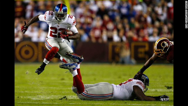 David Wilson of the New York Giants runs the ball against the Washington Redskins on Monday.
