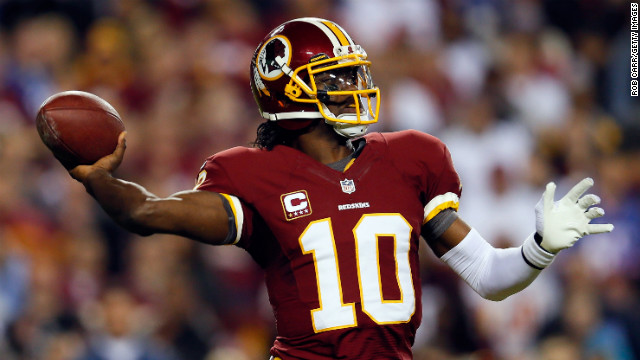 Redskins quarterback Robert Griffin III throws the ball on Monday against the Giants. 