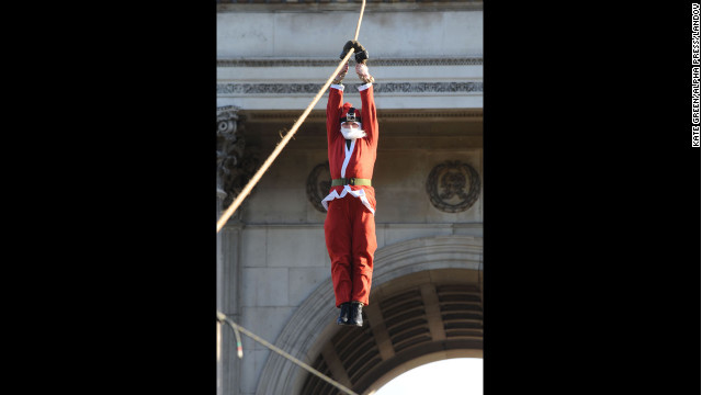 Santa descends on a rope during Christmas Box Launch at Wellington Arch in London's Hyde Park on Tuesday, December 4.