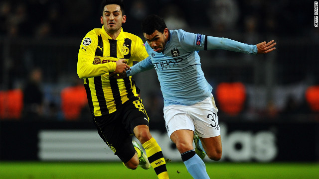 Carlos Tevez takes on Ilkay Guendogan of Borussia Dortmund during a frustrating night for Manchester City as it crashed out of European competition with a 1-0 defeat. City becomes the first English team to have failed to win a single group game in the compeititon.&lt;br/&gt;&lt;br/&gt;