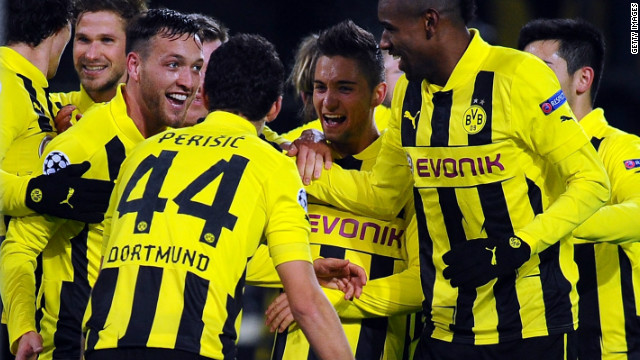 Borussia Dortmund's Julian Schieber celebrates his winner against Manchester City as his team secures top spot in Group D. The Germans finished one point ahead of Real Madrid and will be relishing the knockout phase.