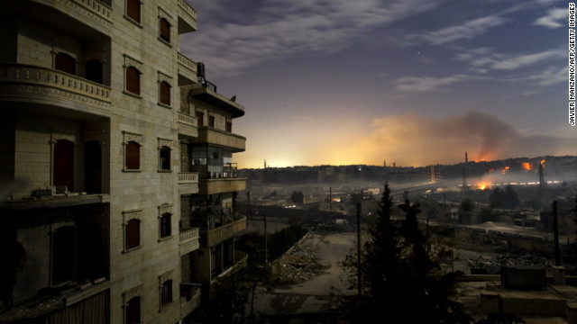 Smoke rises in the Hanano and Bustan al-Basha districts in Aleppo on December 1, 2012 as fighting continues through the night.