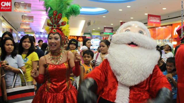 A wacky Christmas parade with dancers, mascots and of course Santa Claus caught iReporter Patricia Garcia's eye during a shopping trip to a local mall.