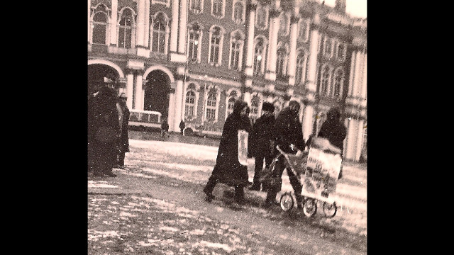 Demonstrations like this one were forbidden on Leningrad's Palace Square, where the Furmans arrived in silent protest on December 6, 1987 -- a date they hoped would change history. Moments before they were arrested, they chained themselves to Aliyah's baby carriage.