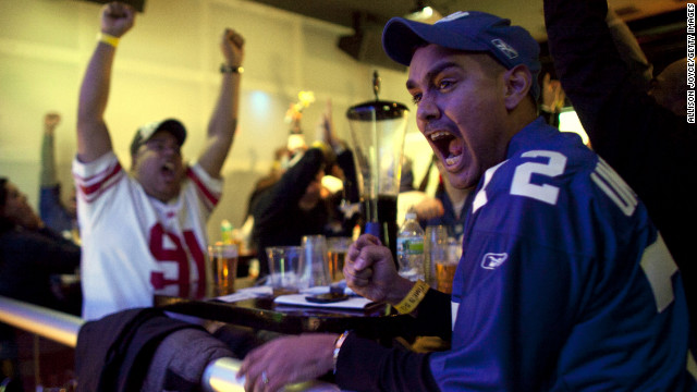 February 5: Football fans watch the New York Giants take on the New England Patriots in Super Bowl XLVI at Tonic Bar in New York. The Giants defeated the Patriots 21-17.