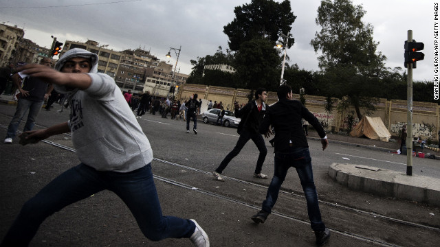 Supporters of Morsy clash with anti-Morsy protesters outside the Egyptian presidential palace on Wednesday, December 5, in Cairo.