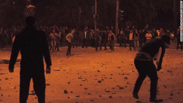 Members of the Muslim Brotherhood and supporters of Morsy clash with anti-Morsy demonstrators on a road leading to the Egyptian presidential palace on December 5.