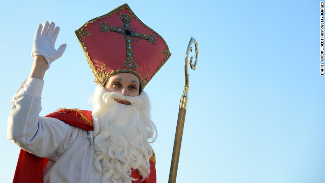 A man dressed as a Santa Claus waves at the port in Hamburg, Germany, on December 6.