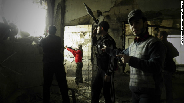 In this handout from the Shaam News Network, Free Syrian Army fighters stand guard against forces loyal to Syrian President Bashar al-Assad in the Al-khalidiya neighborhood of Homs on Tuesday, December 4.