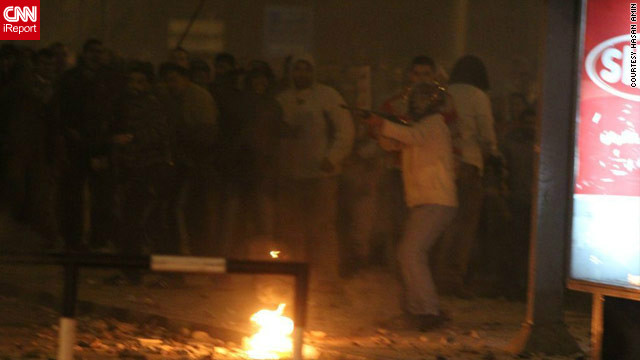 On December 5, pro- and anti-Morsy protesters fought bloody battles on the streets outside the palace. Several deaths have been reported and hundreds of people have been injured, authorities say. iReporter Hasan Amin said &lt;a href='http://ireport.cnn.com/docs/DOC-891413'&gt;in this image&lt;/a&gt;, a pro-Morsy supporter pointed what appears to be a rifle at protesters on the opposing side. The military rolled tanks into protest flashpoint areas, but many fear more violence ahead of a planned constitutional referendum on December 15.