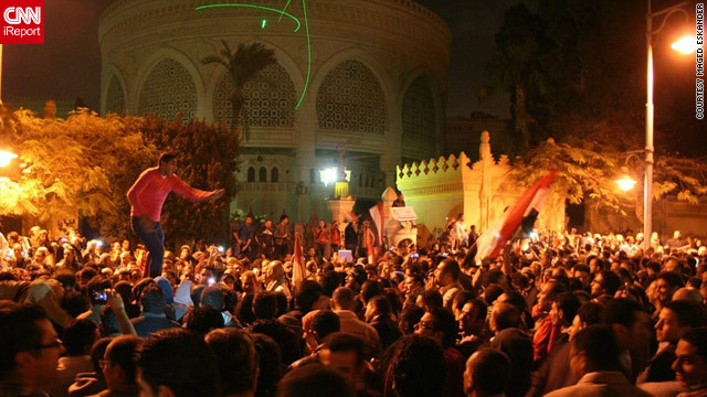 Pro- and anti-government protesters have filled the streets of Cairo since last month, when Egyptian President Mohamed Morsy moved to extend his powers in a move he said was to protect the country's nascent revolution. In this image by iReporter Maged Eskander from December 4, anti-Morsy protesters can be seen &lt;a href='http://ireport.cnn.com/docs/DOC-891041'&gt;thronging the area&lt;/a&gt; around the presidential palace.